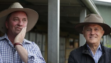 Prime Minister Malcolm Turnbull and candidate for New England Barnaby Joyce at a polling booth  in Tamworth during the New England by-election