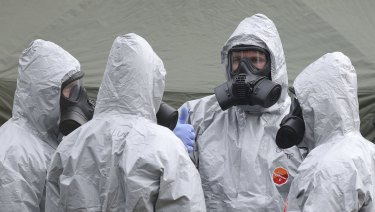 Military personnel conduct their investigations into the Skripal poisoning case in Salisbury.