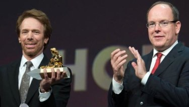 Prince Albert II of Monaco, right, presents the Crystal Nymph to producer Jerry Bruckheimer at the Monte Carlo Television Festival.