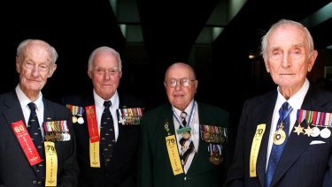 """Sir John Carrick (right) at a ceremony at Shores school in 2008 to recognise the  """"Thirty-Niners"""" - men who served in the reserve forces prior to WWII."""
