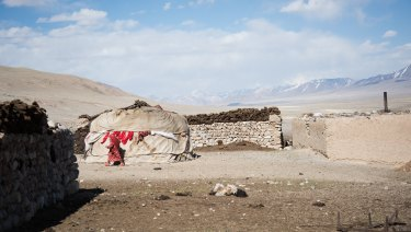 Kyrgyz huts are scattered throughout the corridor.
