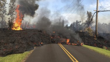 Lava from Fissure 7 slowly advances to the northeast on Hookapu Street in the Leilani Estates subdivision in Pahoa, Hawaii.