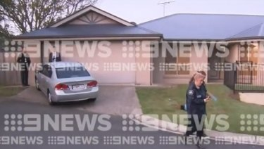 The Kuraby home being searched by police.