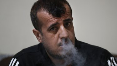Abdullah Khalaf, 35, a Syrian former IS member smokes, at a Kurdish-run prison in Qamishli, north Syria.