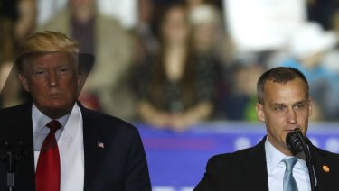 US President Donald Trump, left, watches as Corey Lewandowski speaks during a campaign rally in 2016.