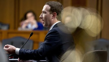 Facebook CEO Mark Zuckerberg testifies before a joint hearing of the Commerce and Judiciary Committees on Capitol Hill in Washington on Tuesday about the use of Facebook data to target American voters.