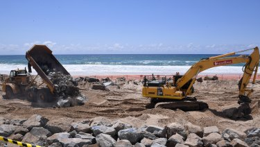 Cyclone preparations in full swing on the Gold Coast, with the construction of a sea wall to try to reduce erosion.