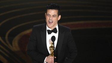 Rami Malek accepts his best actor Oscar for Bohemian Rhapsody.