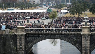 Well-wishers cross a bridge to head to Emperor's 85th birthday celebration at the Imperial Palace in Tokyo on December 23.