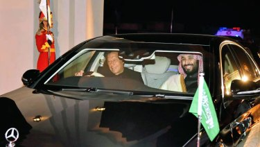 Pakistani PM Imran Khan, left, drives Saudi Crown Prince Mohammed bin Salman in Rawalpindi, Pakistan, on Sunday.