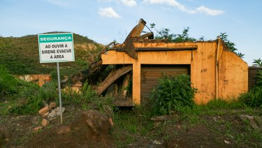 """Safety, leave the area when siren sounds"". A siren system and evacuation route signs were only installed in Bento Rodrigues, Brazil, after the 2015 dam disaster."