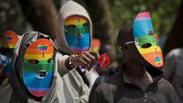 Kenyan people who identify as gay and lesbian and others supporting their cause wear masks to preserve their anonymity in Nairobi.