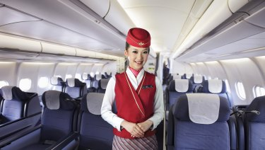 A flight attendant on a China-domiciled airline.