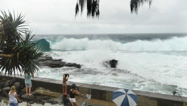 The big swell whipped up by TC Oma mixed with abnormally high tides at Snapper Rocks on the Gold Coast.