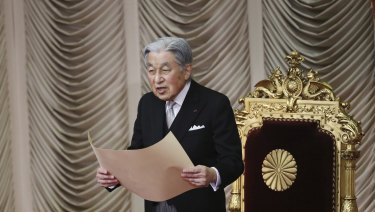 Japanese Emperor Akihito reads a statement to formally open a session in the upper house of Parliament in Tokyo last month.