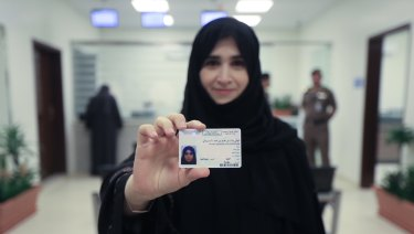 A Saudi women displays her licence at the General Department of Traffic in the capital, Riyadh.