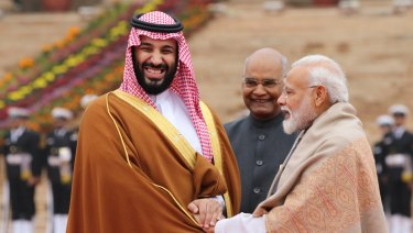 Mohammed Bin Salman, left, is greeted by Indian President Ram Nath Kovind, centre, and Prime Minister Narendra Modi at the presidential palace in Delhi.