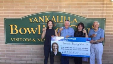 Liberal candidate Georgina Downer presents a novelty cheque for $127,000 to the Yankalilla Bowling Club.