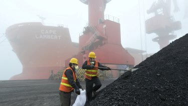 Chinese workers taking samples of imported coal at a port in Rizhao. Trade Minister Simon Birmingham said he has no reason to believe China is banning Australian coal.