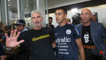Craig Foster with refugee footballer Hakeem al-Araibi at Melbourne International Airport on February 12.