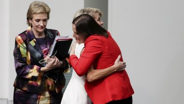 Julie Bishop and Kelly O'Dwyer embrace after the former foreign minister announced her retirement from politics.