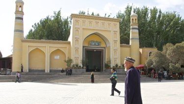 An elderly Uighur man in front of Kashgar's Id Kah mosque in Xinjiang, China.