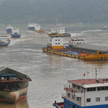 Cargo ships sail into Chongqing's free-trade port, connected to 13 rail lines.