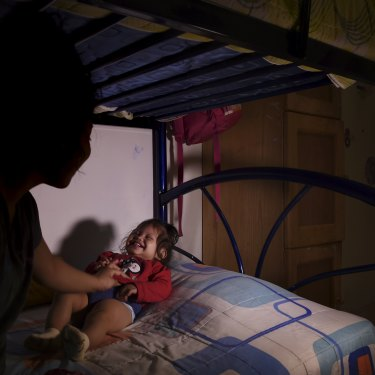 Blanca, 1, with her mother, Lupita, 13, at a home for unaccompanied minors.