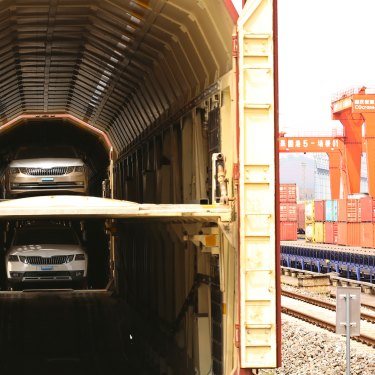 Cars made in Shanghai loaded on a train to Chongqing.