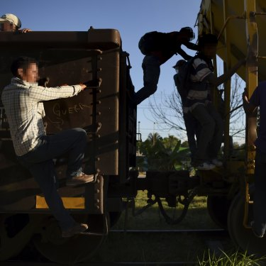 "Young men ride La Bestia (""The Beast"") – the freight train that heads north from Guatemala, through Mexico and on to the US border – at the Mexican town of Tenosique."