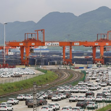 Cars and containers ready to be freighted out of Chongquin.