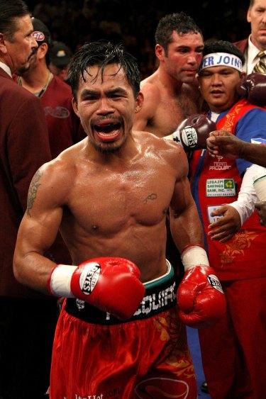 I got your back: Buboy Fernandez congratulates the beaten Oscar de la Hoya after Manny Pacquiao's win in 2008.