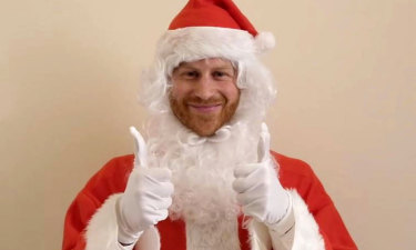 In a video, Prince Harry sends festive wishes to nearly 200 children at a party put on by the Scotty's Little Soldiers charity.