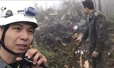 Emergency teams work at the crash site.