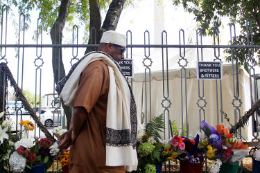 A year on from the Christchurch terror attacks, a member of the Muslim community arrives at Masjid An-Nur mosque in Christchurch, New Zealand.