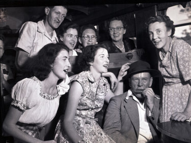 Passengers enjoying themselves en route to Robertson during a railway scenic tour on 8 February 1953.