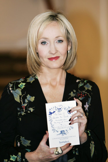 British writer J.K. Rowling, with a copy of The Tales of Beedle the Bard, now on Audible.