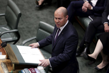 Treasurer Josh Frydenberg delivering last year's budget which forecast a surplus of $7.1 billion and a lid on spending. Now facing a deficit of more than $200 billion, the treasurer is being urged to lift spending.