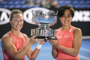 Samantha Stosur (left) and doubles partner Zhang Shuai with the silverware.