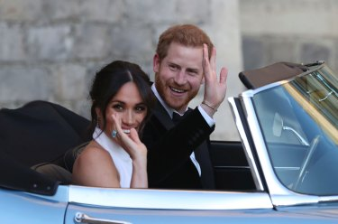 0825d5cacde The newly married Meghan Markle and Prince Harry leave Windsor Castle in a  convertible after their