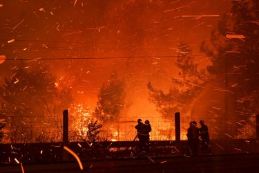 Greek firefighters battle monster fires this week that the government has blamed, in part, on climate change.