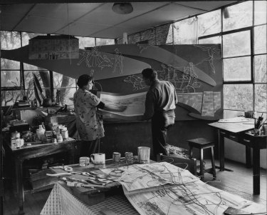 Roma Hilder and her husband, Bim Hilder, assembling the mural of the first Easter Show which they have designed for the staff restaurant at Grace Brothers, Parramatta. June 10, 1957.
