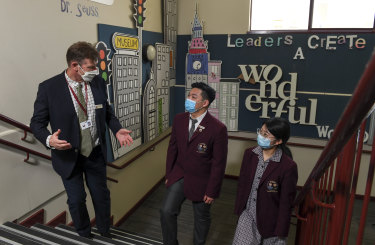 Oakleigh Grammar principal Mark Robertson with international students Sinky and Betty.