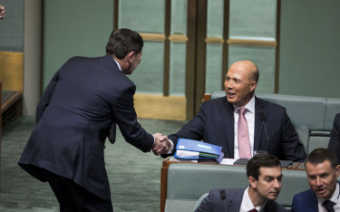 Conservative agitator Kevin Andrews congratulates Dutton.