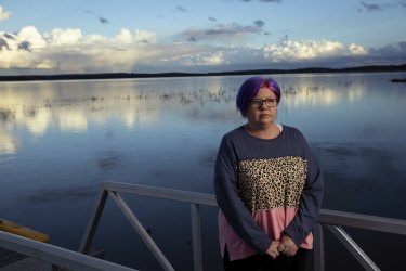 Tania Magoci, a motor neurone disease sufferer, standing by Lake Wyangan, near Griffith in the NSW Riverina.