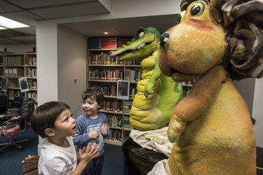 William Lowry and Hugo French get up close with Calvin the Crocodile and Leo the Lion.