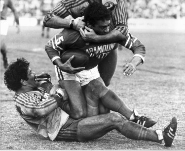 Kevin Stevens and a teammate tackle Newtown's Ray Blacklock.