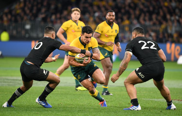 Evasive: Matt Toomua during the clash with New Zealand.