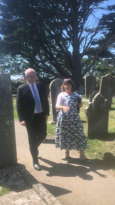 Karen Richards gives Scott Morrison a tour of the St Keverne graveyard.
