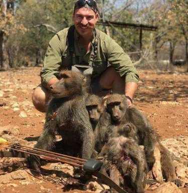 Idaho Fish and Game Commissioner Blake Fischer poses with 'a whole family of baboons' he says he shot on a recent hunting trip in Africa.
